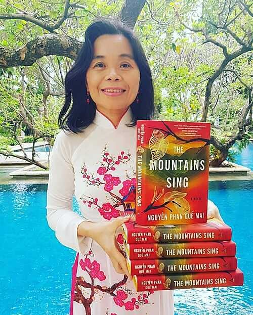 Nguyen Phan Que Mai with her book The Mountains Sing. Photo courtesy of Mais Facebook