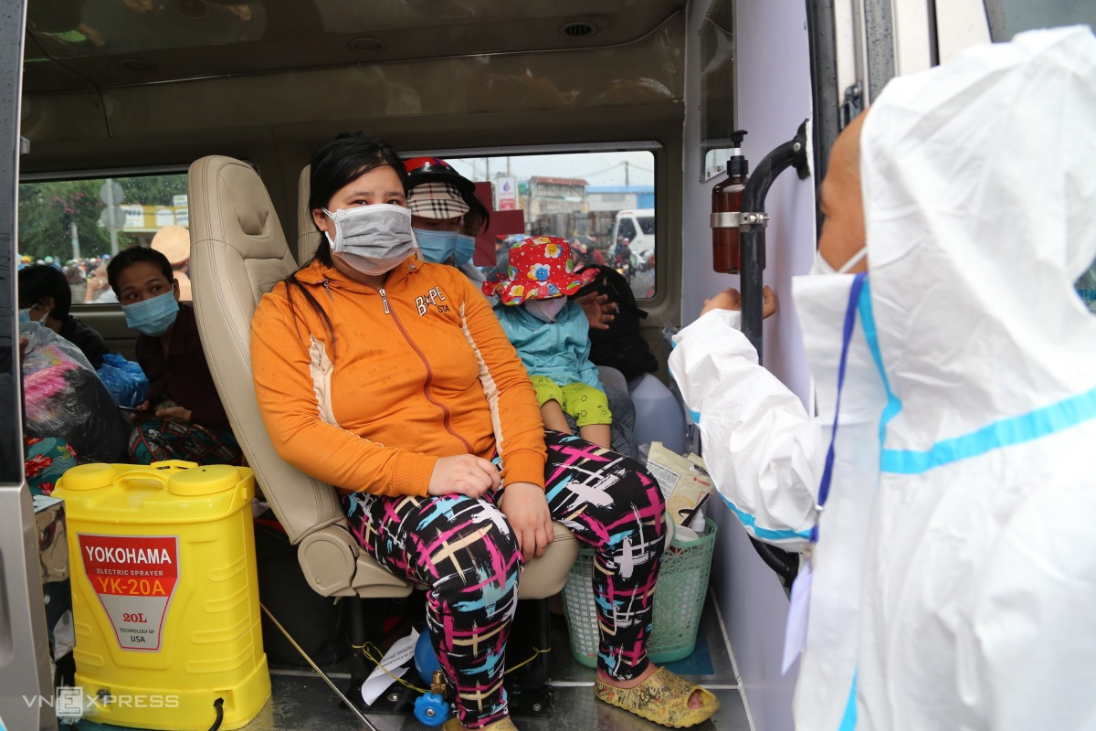 Wearing protective gear, driver Pham Van Thai guided people to get on the bus and find their seats.I drive people to centralize quarantine facilities in provinces today. I will not stop on the way, and we have prepared food and water for passengers to have, he said, adding his bus was registered with local authorities for charitable works.