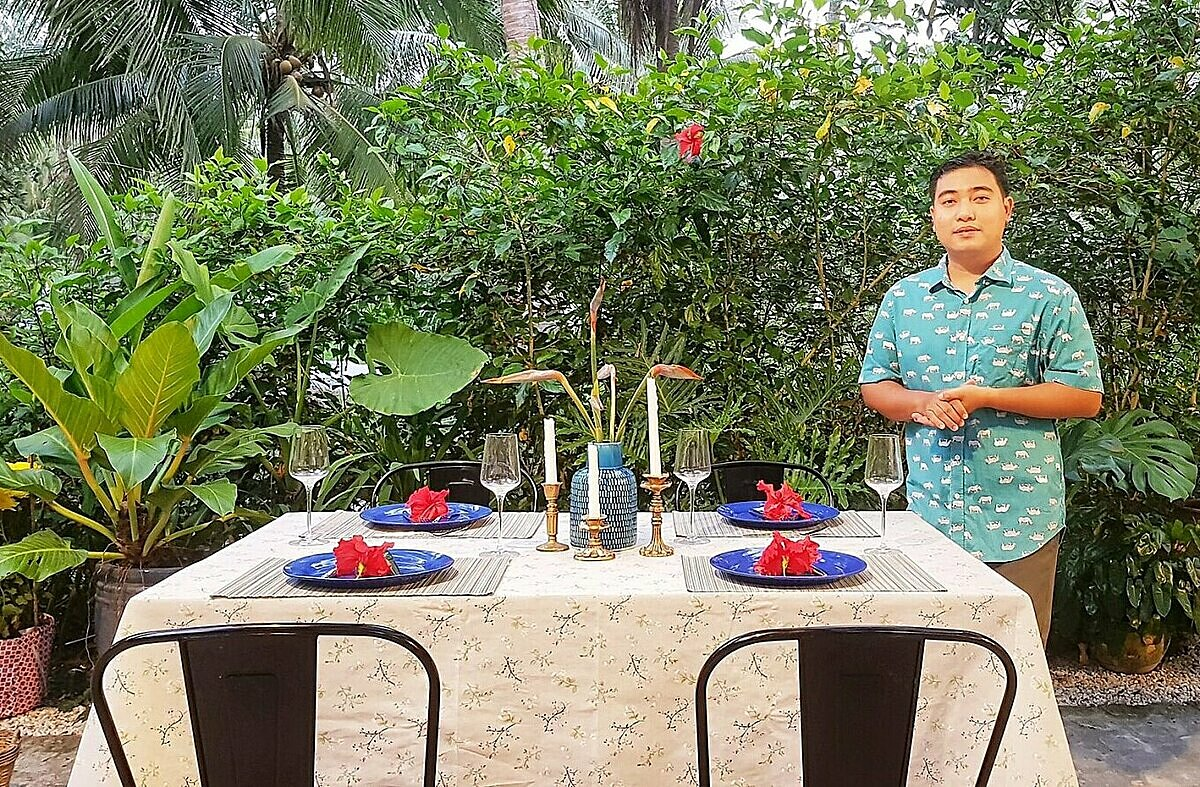 Quach Duy Thinh prepares dining table for guests at one of his homestays in Ben Tre Province, February 2021. Photo courtesy of Thinh