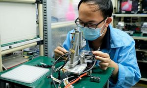 Anxious HCMC companies support workers amid closures to keep them