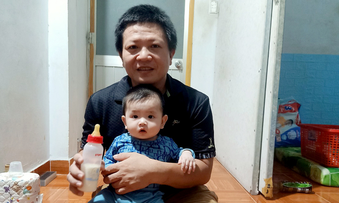 Huynh Thanh Hau and his eldest son in their home in HCMCs Binh Tan District. Photo by VnExpress/Tan Phat