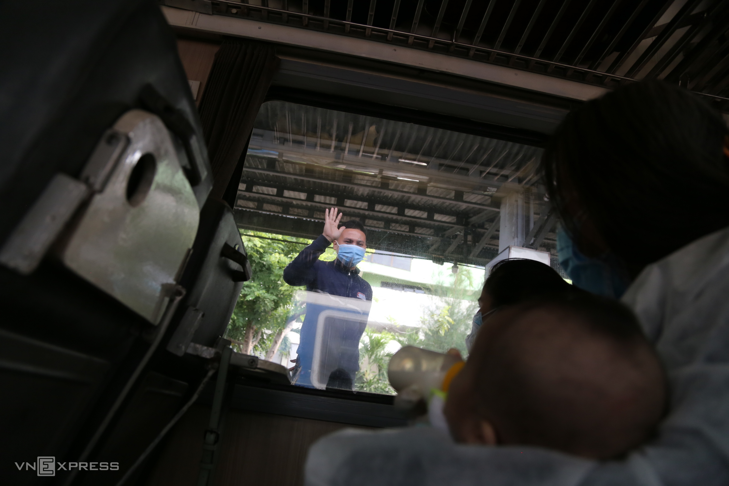 Mothers, children and the elderly return home by train from HCMC