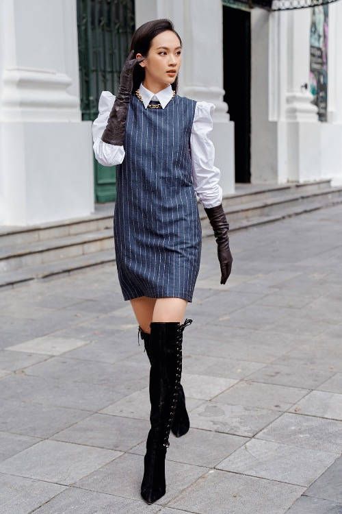 A tuxedo-inspired dress combining with a white shirts and boots creates a perfect look for Hanoi autumn days.