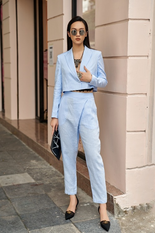 The blue blazer is inspired from crop-tops, combining with asymmetrical pants.