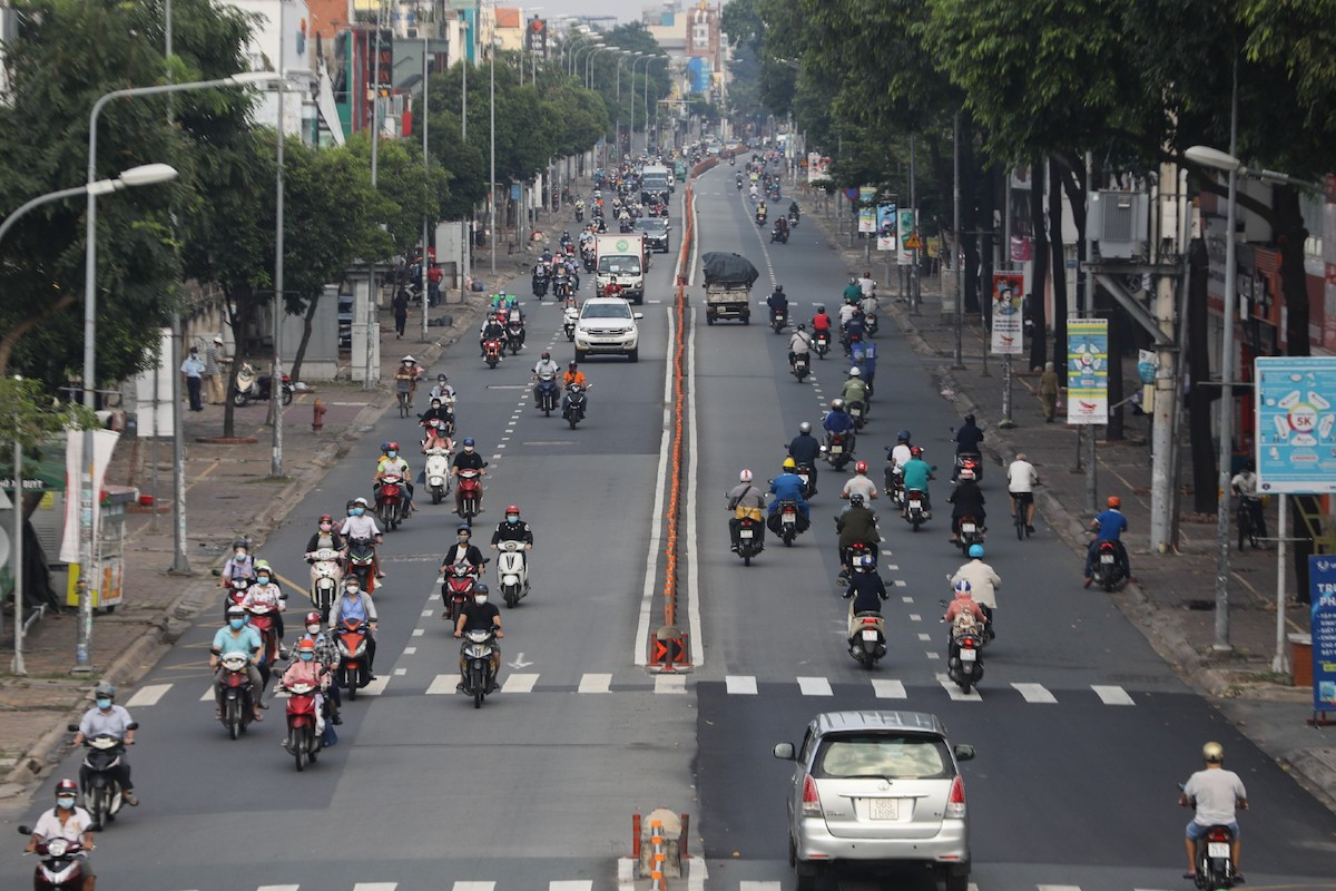 Vehicles are seen in Ho Chi Minh City on October 1, 2021 as the city begins to resume activities after months of social distancing. Photo by VnExpress/Quynh Tran