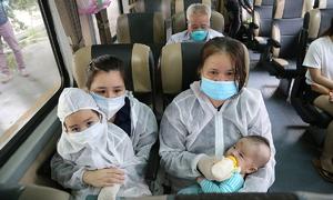 Mothers, children, elders get train rides home from HCMC