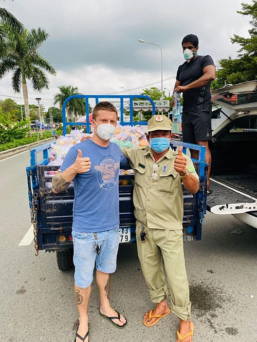 Robin Deepu (first from right) and his friends deliver food kits to the needy in HCMC, Sept. 2021. Photo courtesy of Robin Deepu