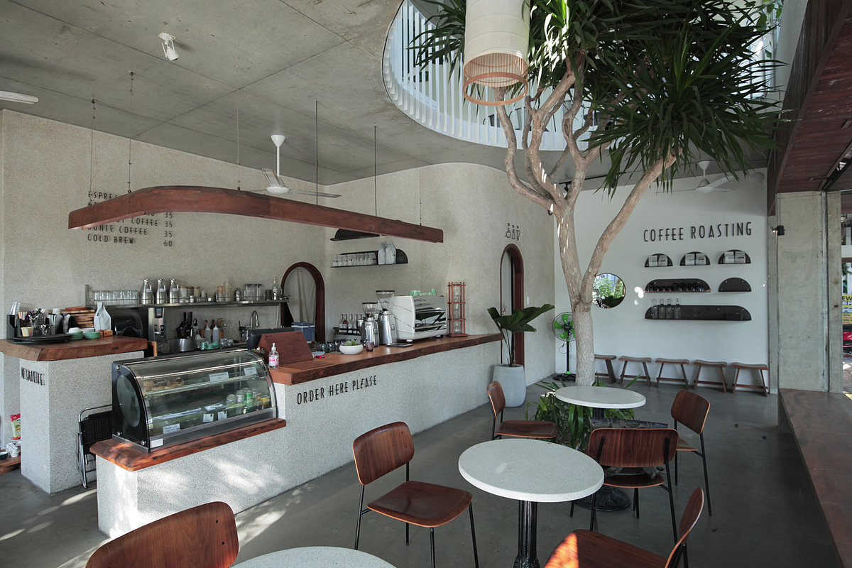 The bar area is located on the ground floor with an open design, allowing guests to witness the coffee brewing process as they order.