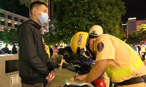 Patrols tighten in downtown HCMC following disregard of Covid-19 prevention