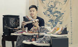 Artist gives common shoes a royal touch